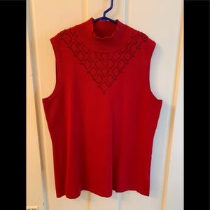 Sleeveless beaded front turtleneck polyester top